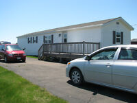 Large mini home on owned 1 acre lot. 5 min from beach. See remar