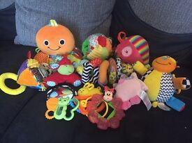 Bundle soft toys pram/car seat toys and rattles excellent condition