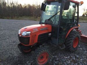 Kubota tractor with front snow blower and box blade.