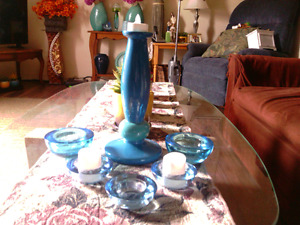 6 pc. Blue glass candle holder set w 3 LED candles. 10.00 all.
