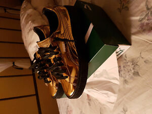 Gold puma sneakers!