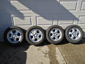All season tires P215/60R16 on rim x4, like new