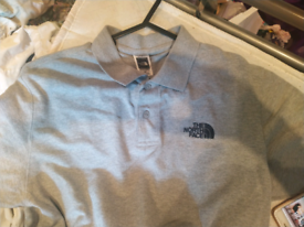 The north face grey polo shirt size small