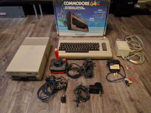 Commodore 64 with floppy drive, box, and accessories