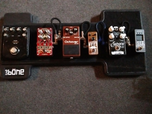 Pedal board and pedals for sale.