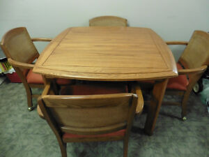 Beautiful Oak Table with four cane back cushion seats with arm