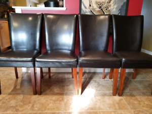 5 leather-look tall back dining chairs