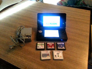 Nintendo 3DS Cosmo Black Edition console with  5 games