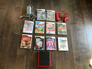 Wii Mini with games, nunchuck,controller and cord,sensor not inc