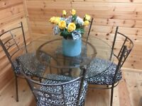 Glass top dining table & chairs