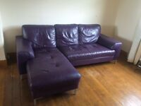 Purple leather corner sofa.