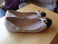New Coach patent leather cream and black shoes size 9.5