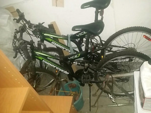 Two mountain bikes cheap with accessories
