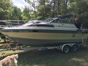 Doral Cabin Cruiser with Cuddy and Trailor - New Motor!!