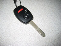 Lost Keys: Honda Key Fob and Other Keys (two with pink rings)