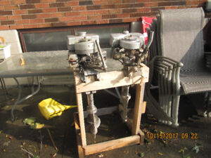 Three antique outboard's  Evinrude's and Firestone