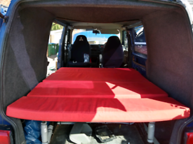 Full width rock and roll bed for camper