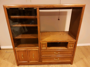 "Oak entertainment unit. Fits 32""flatscreen."