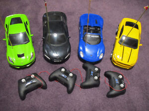 New Bright 1 to 16 Scale Radio Control Cars - like new