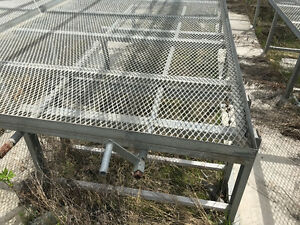 Galvanized metal greenhouse benches