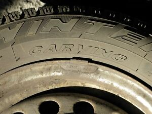 4 Pirelli Winter Carving 185/65R14 on steel rims w/wheel covers West Island Greater Montréal image 4