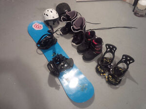 Two pairs of boots, binding, helmets + a board