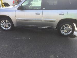 Envoy Denali rims and brand new tires Cooper Discoverer HT