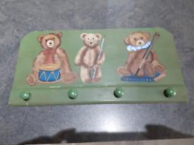 Teddy bear coat hanger