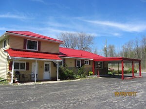 BUY THIS BUSY MOTEL AND LIVE IN FOR FREE !!*