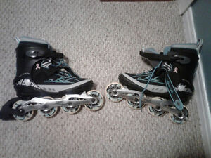 Women's size 8 Roller Blades. Asking 50 o.b.o