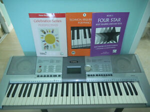 Yamaha keyboard PSR 293 with 3 song books and adapter