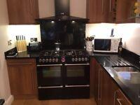 Complete Kitchen with black granite worktops and 7 burner range cooker.