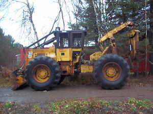 CAT 518 CABLE AND GRAPPLE SKIDDER