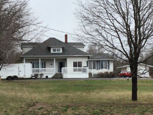 Just outside city close to hwy in-law suite great income