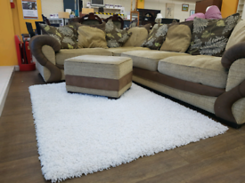Corner sofa with scatter cushions and footstool