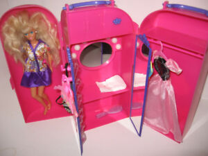 Barbie Vanity with barbie and extra clothes $10.00