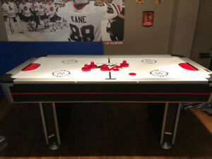 Air Hockey Table with electronic scoring and sounds.