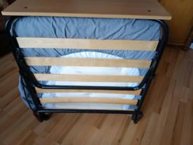Folding bed.