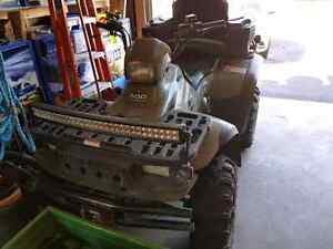 Polaris Magnum 500 with new plow and winch