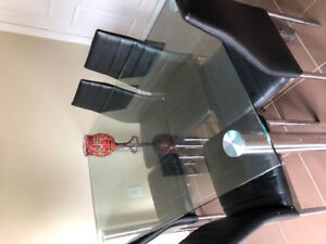 7 piece set , 1 glass table and 6 leather chairs for sale