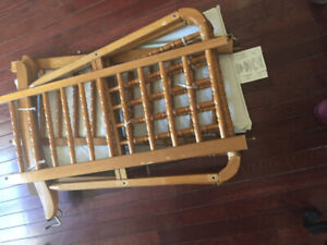 baby seat and wooden cradle