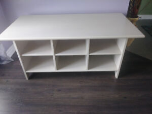 Heavy Ivory wood centre table with built in shelving