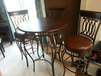 Excellent quality pub table and 3 swivel chairs
