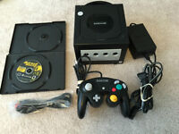 Black NINTENDO GAMECUBE System with hookups and Pac Man game