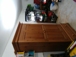 Pine wardrobe and matching chest of drawers and mirror for sale.