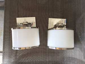 Two wall sconces for sale.