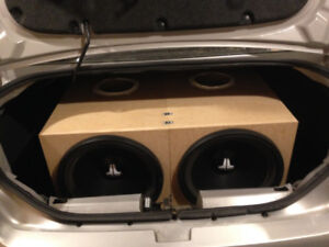 """Two 15"""" JL audio 15w0-8 with custom made boxes."""