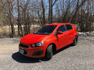2013 Chevrolet Sonic LT with set of snow tires on rims