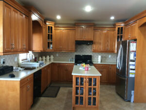 Very good condition maple cabinets and countetops
