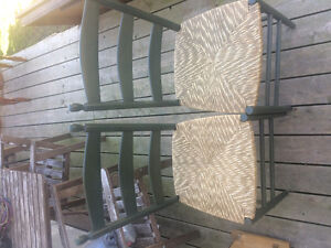 Two wooden and wicker chairs
